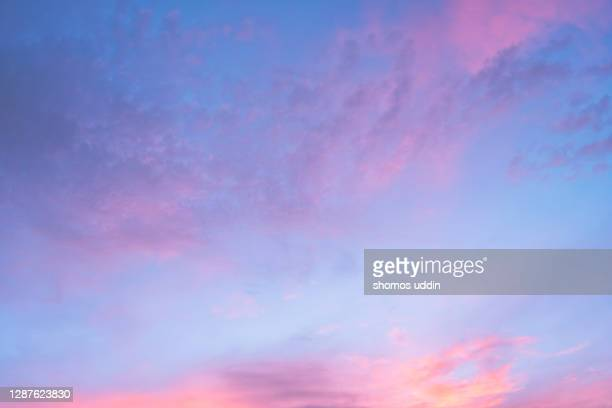 pink and blue sky - pink colour stock pictures, royalty-free photos & images