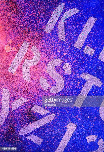 Pink and blue splattered background with alphabetical text