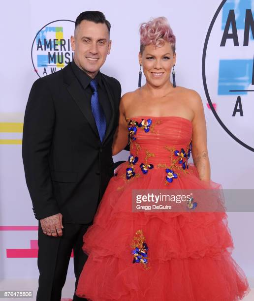 Pink and Carey Hart arrive at the 2017 American Music Awards at Microsoft Theater on November 19 2017 in Los Angeles California