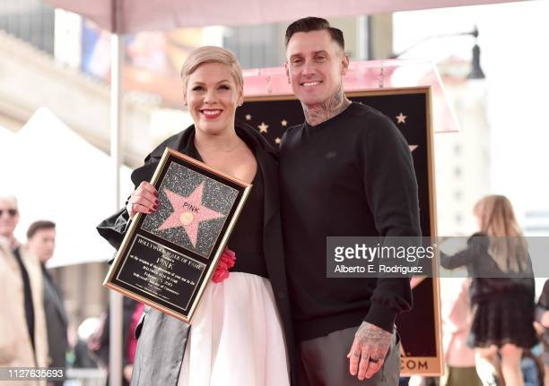 Pink and Carey Hart attend a ceremony honoring her with the 2.656th star on The Hollywood Walk Of Fame on February 05, 2019 in Hollywood, California.
