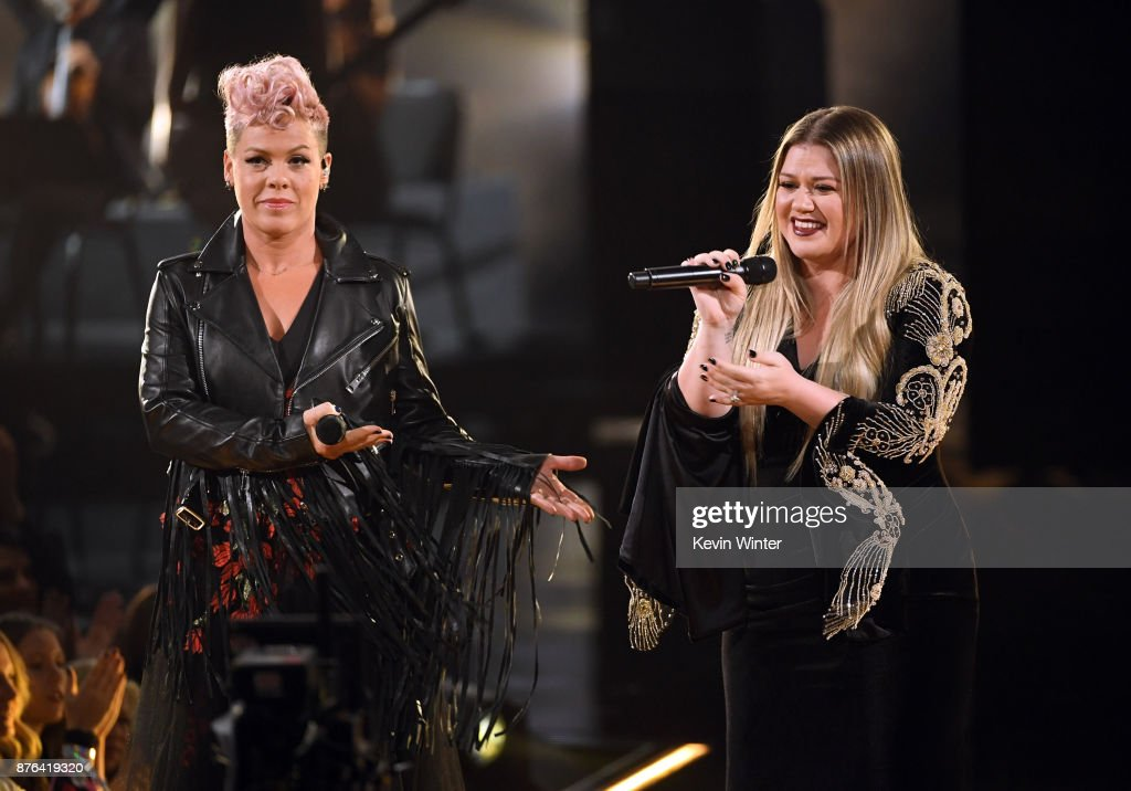 Pink (L) and Kelly Clarkson perform onstage during the 2017 American Music Awards at Microsoft Theater on November 19, 2017 in Los Angeles, California.