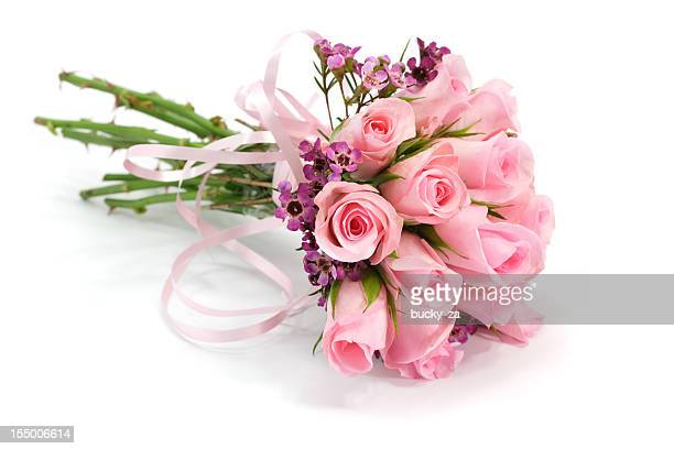 Pink and mauve rose flower bouquet isolated on white , shadows