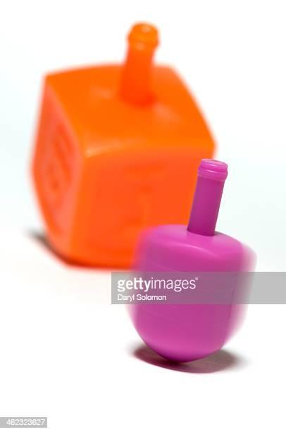 Pink and orange dreidels