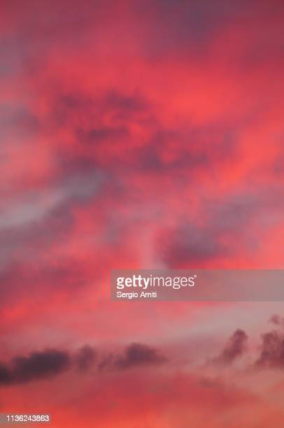 pink and orange sunset sky - colorful sunset stock photos and pictures