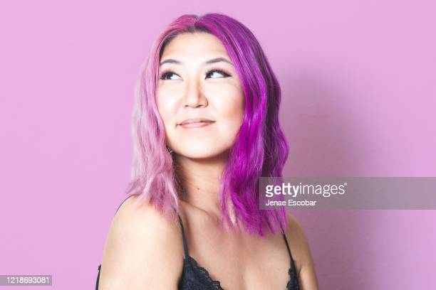 pink and purple hair against matching pink background - dyed hair stock pictures, royalty-free photos & images