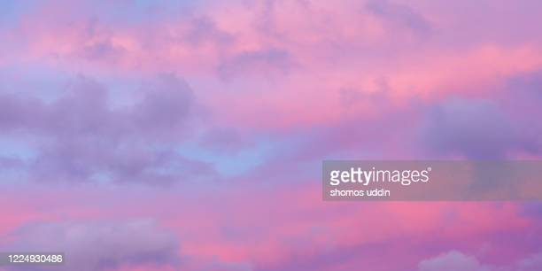 pink and violet colour sky at sunset - cloudscape stock pictures, royalty-free photos & images