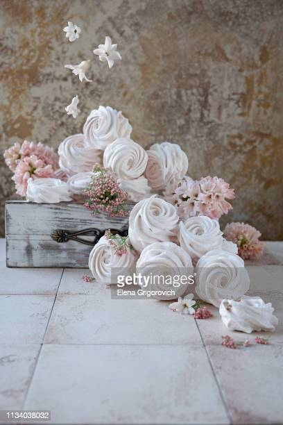 pink and white russian marshmallows in old wooden box. flying spring flowers - wedding background stock pictures, royalty-free photos & images
