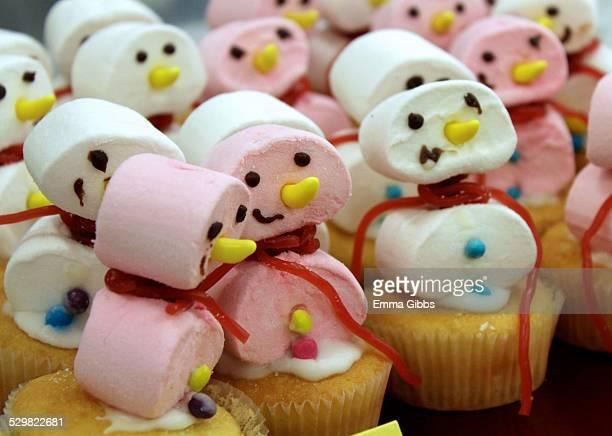 Pink and white snowmen cake