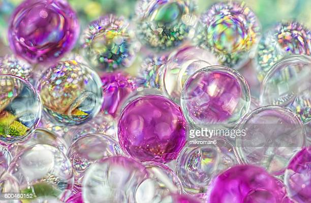 pink and white sparkling pearls background - gel effect lighting stock photos and pictures