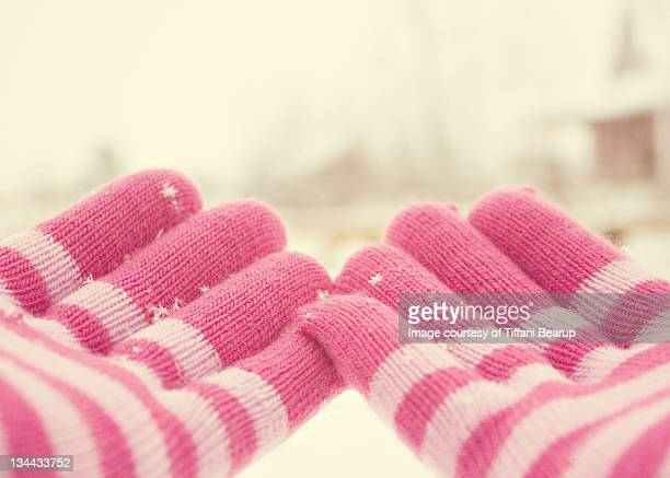 pink and white striped gloves - erie pennsylvania stock pictures, royalty-free photos & images