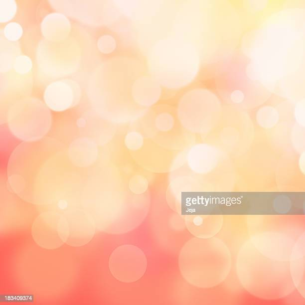 A pink and yellow bokeh effect background