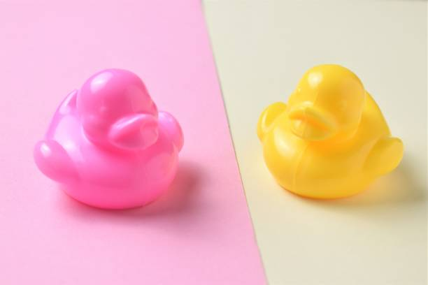 Pink and yellow ducklings on yellow and pink background