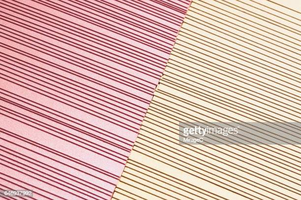pink and yellow paper stacking - champagne coloured stock photos and pictures