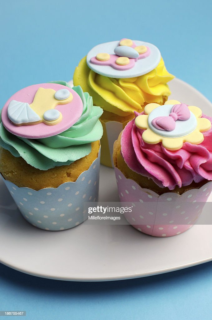 Pink Aqua Blue And Yellow Baby Shower Cupcakes Stock Photo Getty