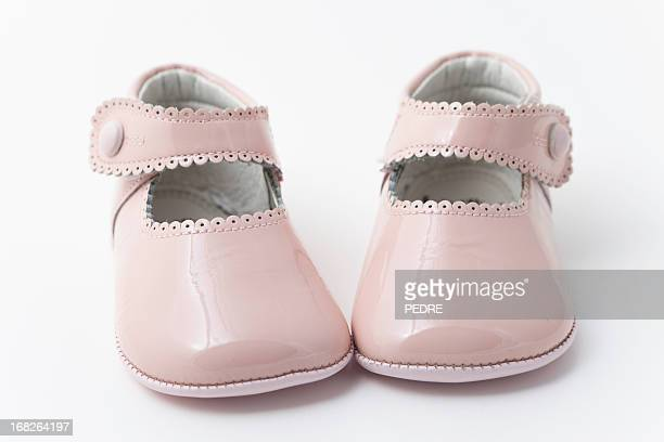 pink baby booties - baby booties stock photos and pictures
