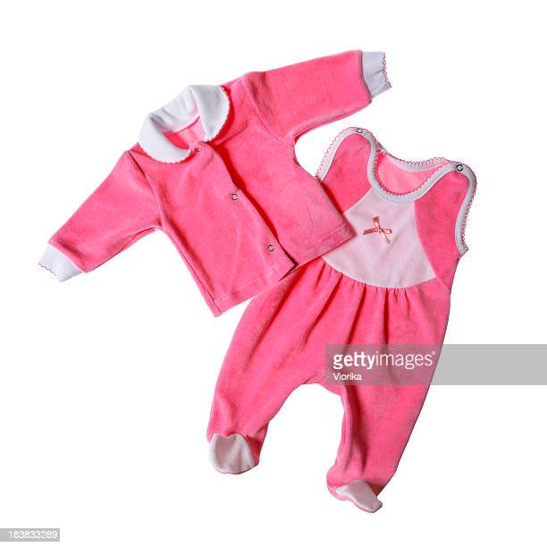 Pink baby clothes on white background