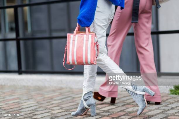 A pink Balenciaga bag white pants velvet heels outside Preen by Thornton Bregazzi on day 3 of the London Fashion Week February 2017 collections on...