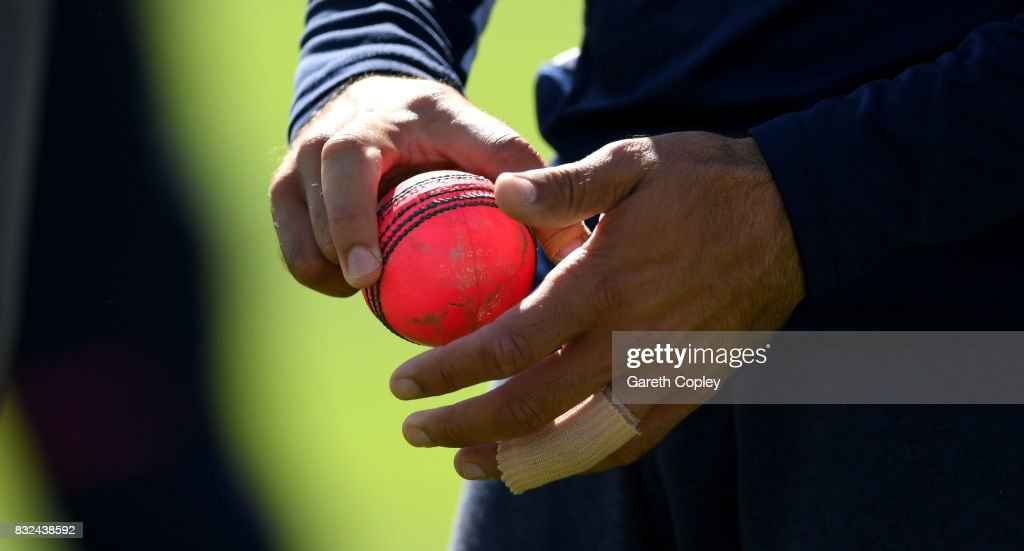 A pink ball is held by Moeen Ali of England during a nets session at Edgbaston on August 16, 2017 in Birmingham, England.
