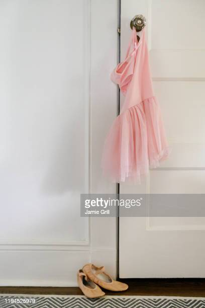 pink ballet tutu hanging on doorknob - montclair stock pictures, royalty-free photos & images