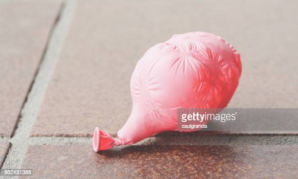 A pink balloon deflated