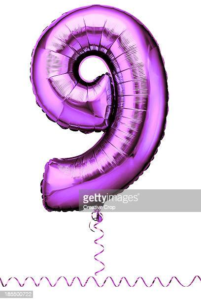 Pink balloon in the shape of a number nine
