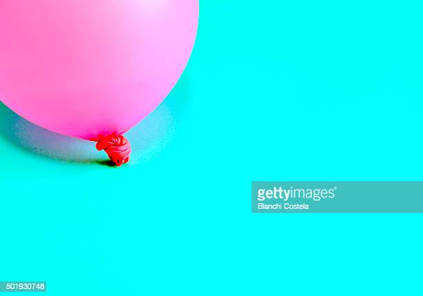 Pink balloon on blue background
