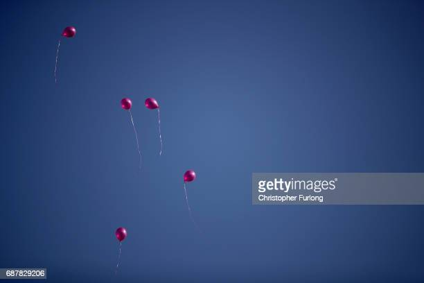 Pink balloons are released into the sky above tributes in St Ann's Square on May 24 2017 in Manchester England on May 24 2017 in Manchester England...