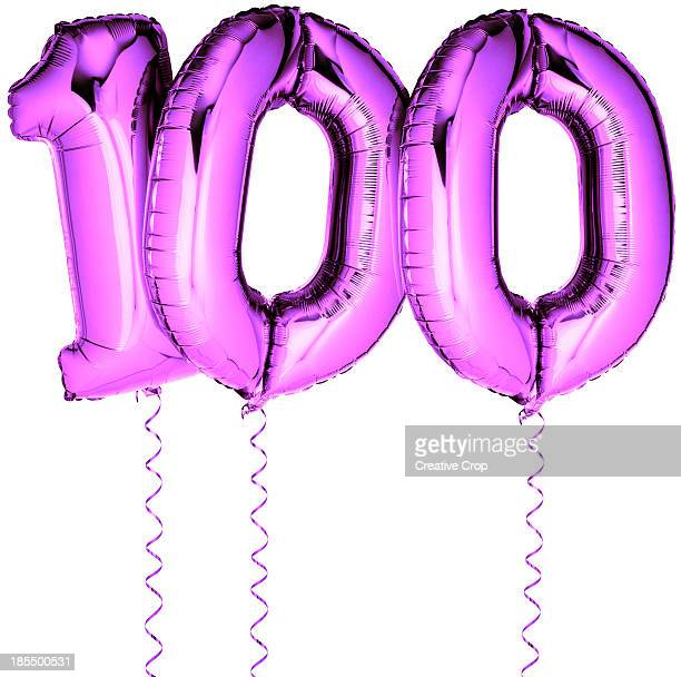 Pink balloons in the shape of a number 100