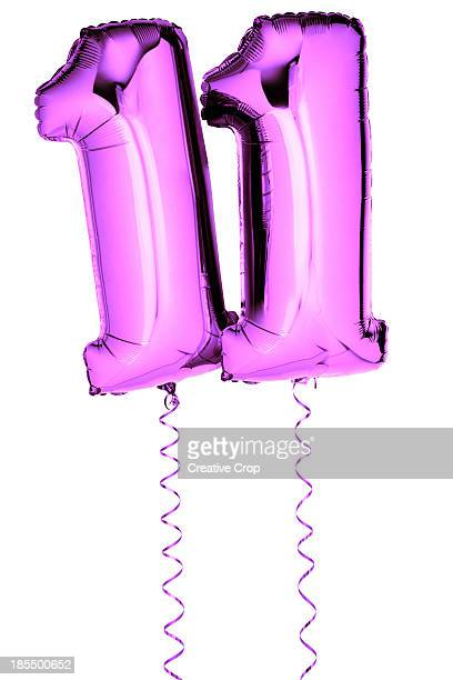 Pink balloons in the shape of a number 11