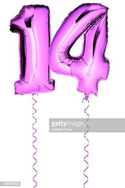 pink balloons in the shape of a number 14 - number 14 stock photos and pictures