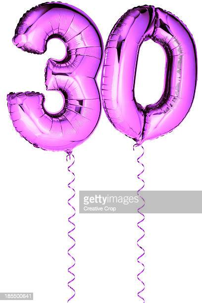 Pink balloons in the shape of a number 30