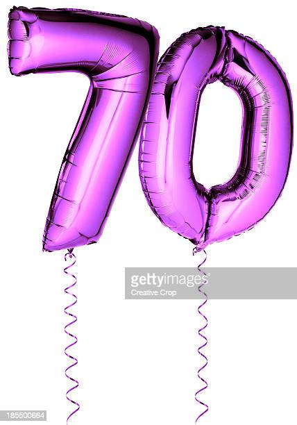 Pink balloons in the shape of a number 70