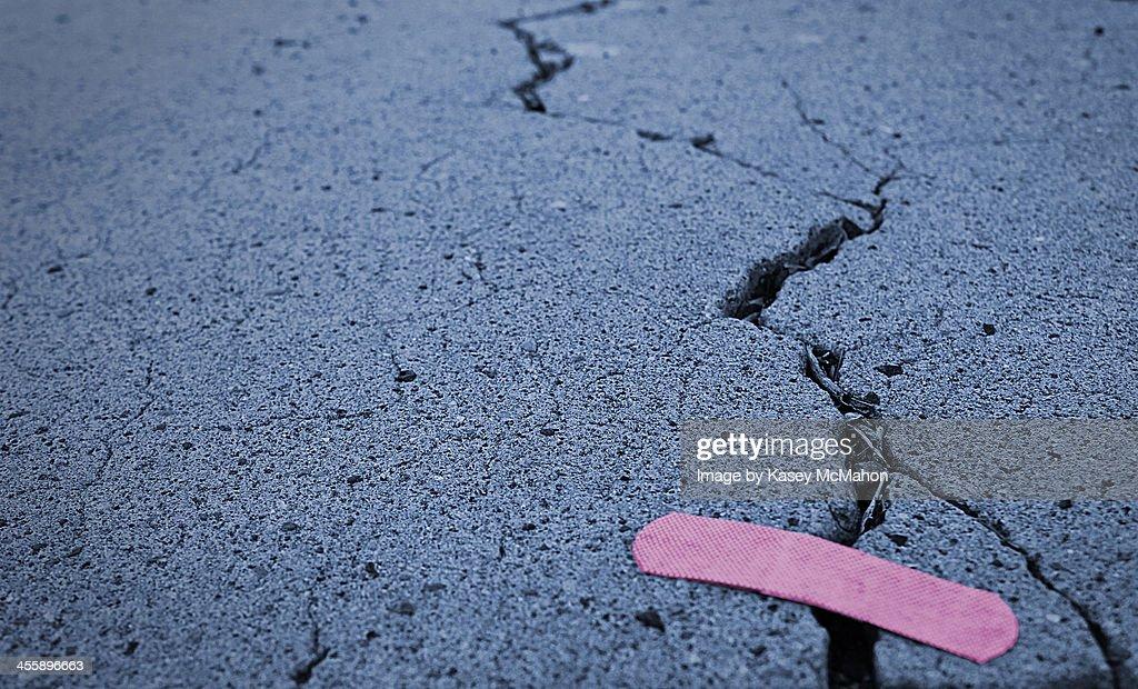 Pink bandage on concrete : Stock Photo