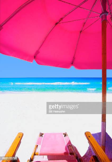 pink beach lounge chair in florida - destin beach stock pictures, royalty-free photos & images