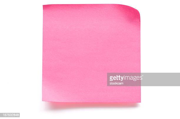 Pink blank note paper isolated on white