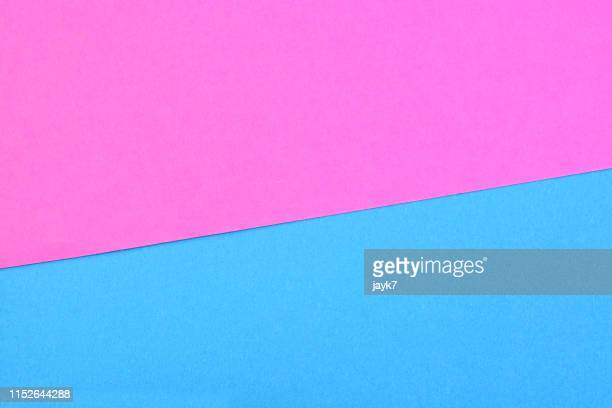 pink blue colored paper background - pink and blue background stock pictures, royalty-free photos & images