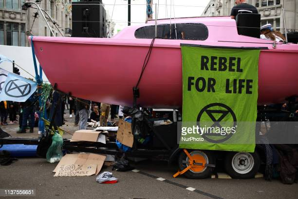A pink boat brought in by members of climate change activist group Extinction Rebellion sits in Oxford Circus in London England on April 16 2019...
