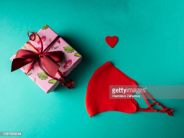 pink box with gift tied with