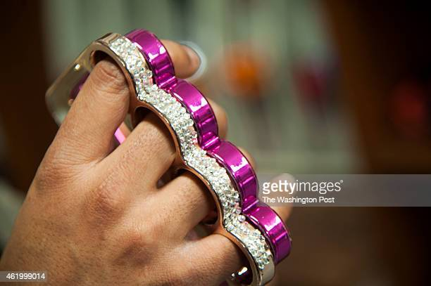 Pink brass knuckles that double as a cell phone case are sold at the Pennsylvania State Surplus store January 6 2015 in Harrisburg PA Items that look...
