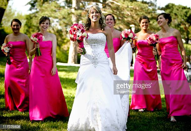 Pink Bride and Bridesmaids Happy Wedding Walking