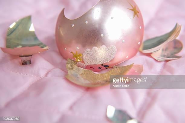 pink broken fragile christmas globe