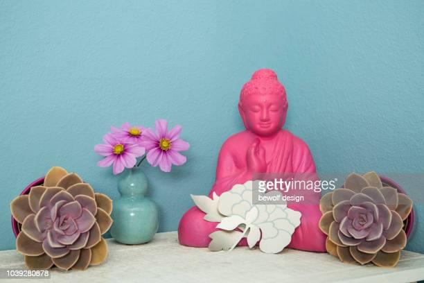 Pink buddha figure