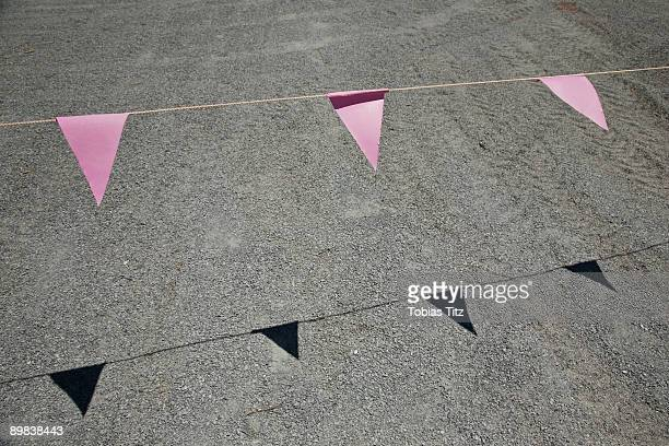 Pink bunting hanging above a road