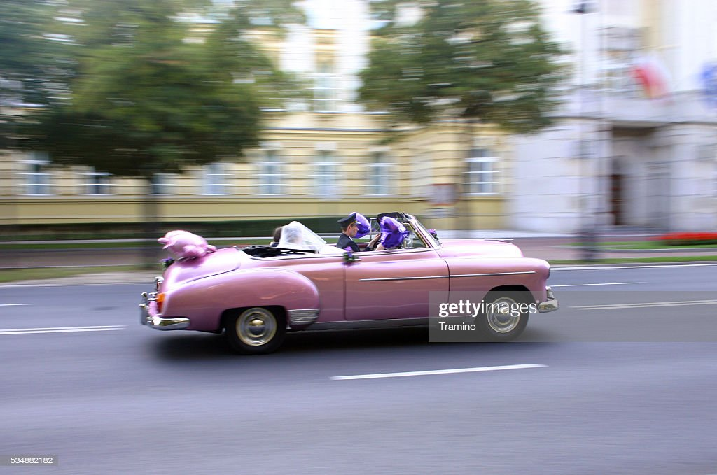 Pink Cadillac Wedding Car In Motion Stock Photo