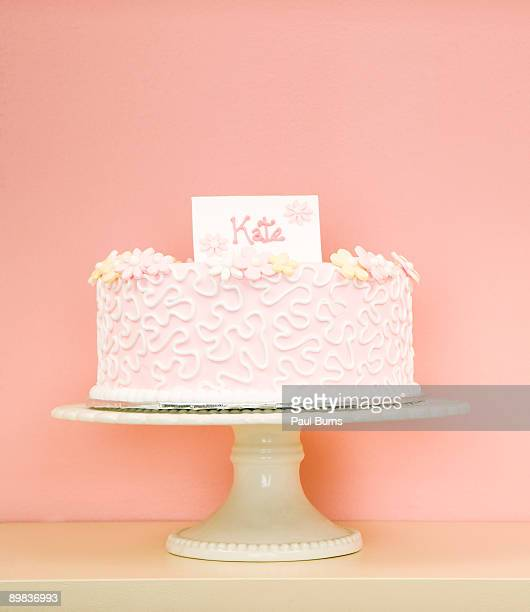 Pink Cake on Serving Dish With Name Tag