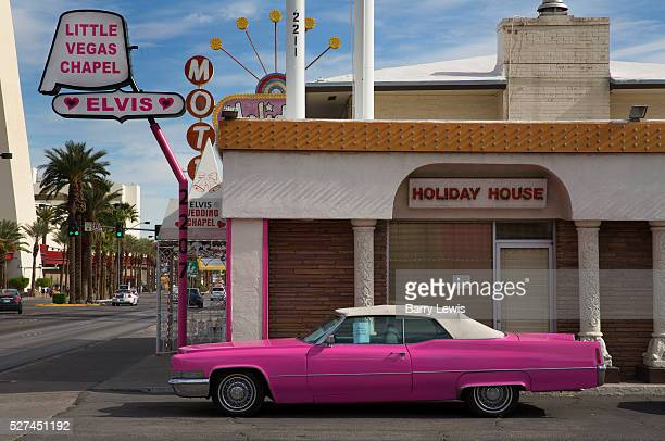 Pink Car outside Las Vegas wedding chapel with Elvis sign,