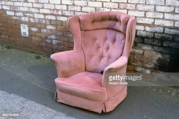 pink chair by roadside - housing difficulties stock pictures, royalty-free photos & images