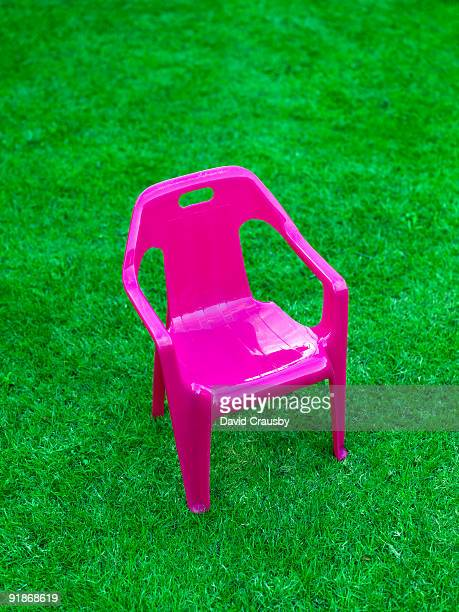 pink chair on a lawn - crausby stock pictures, royalty-free photos & images
