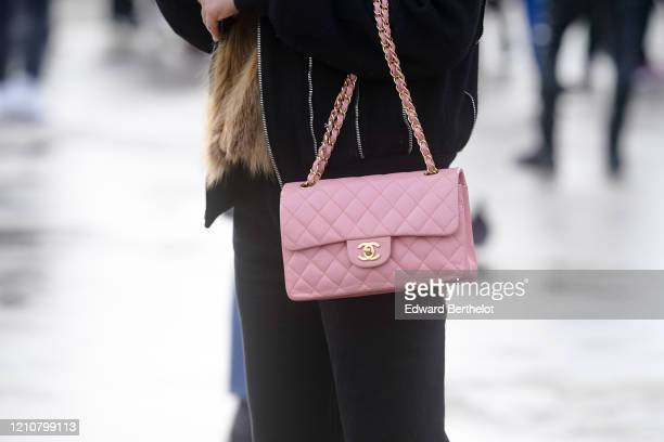 Pink Chanel bag is seen, outside Chanel, during Paris Fashion Week - Womenswear Fall/Winter 2020/2021 on March 03, 2020 in Paris, France.