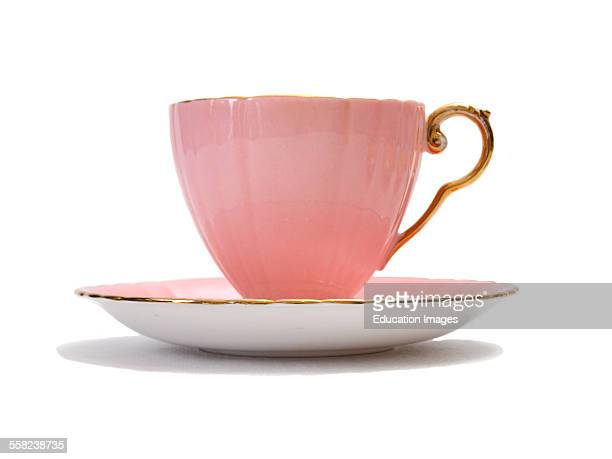 Pink china tea cup on a white background